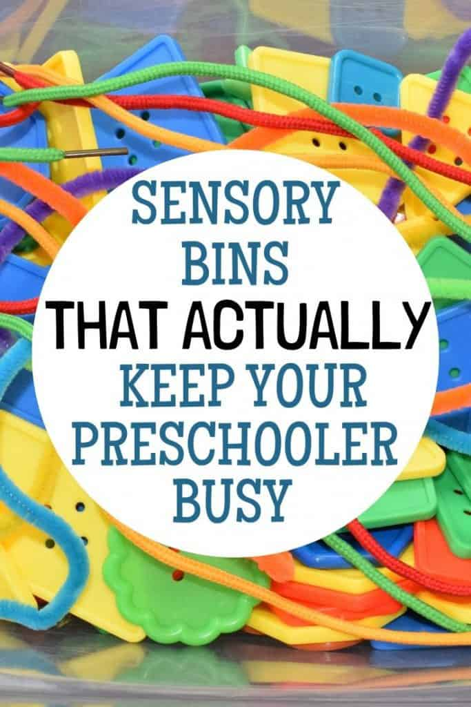 Sensory bin filled with buttons, pipe cleaners and shoe laces.