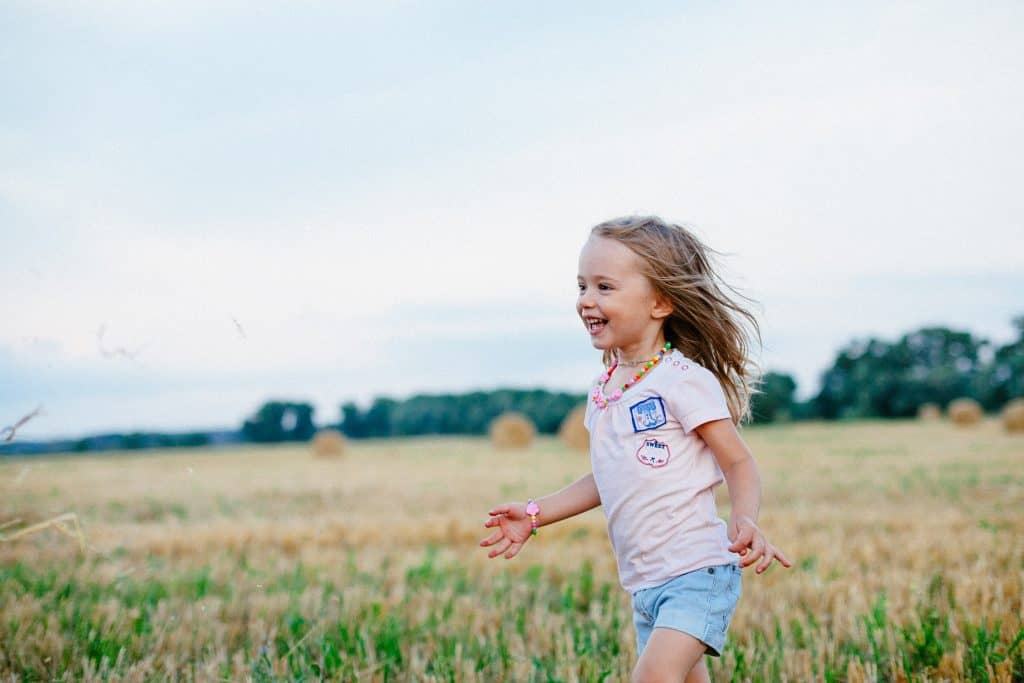Carefree girl running in the field