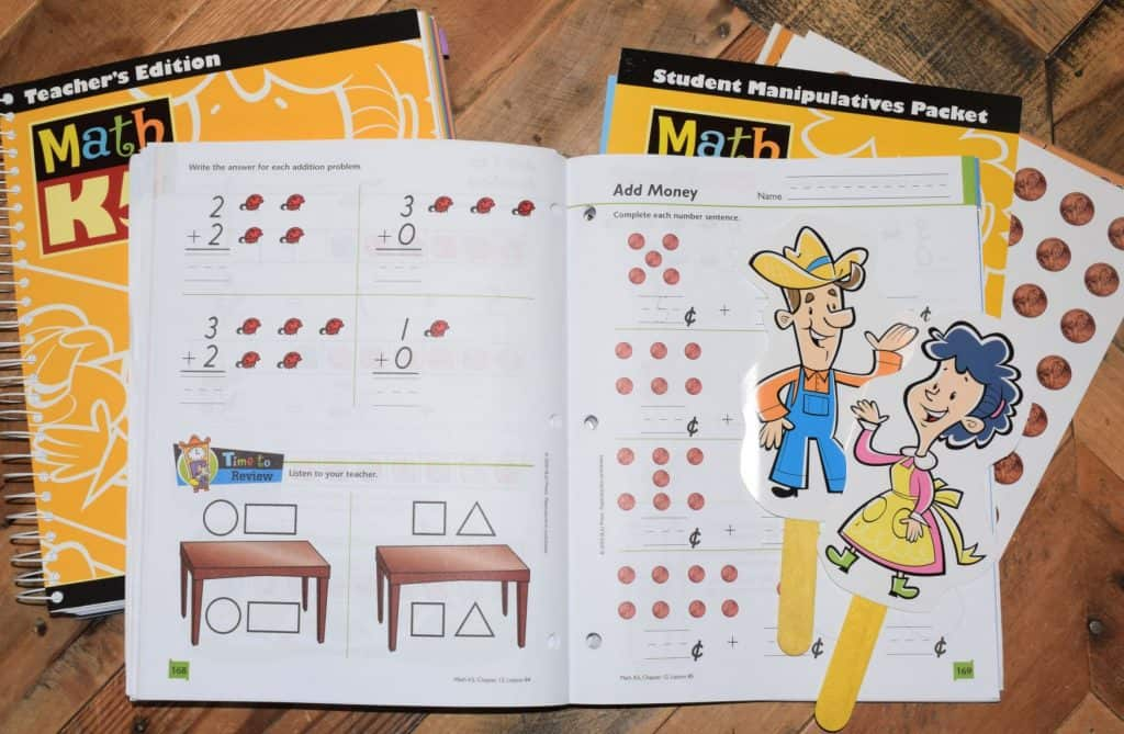 Math kindergarten curriculum for homeschooling spread out on a coffee table.