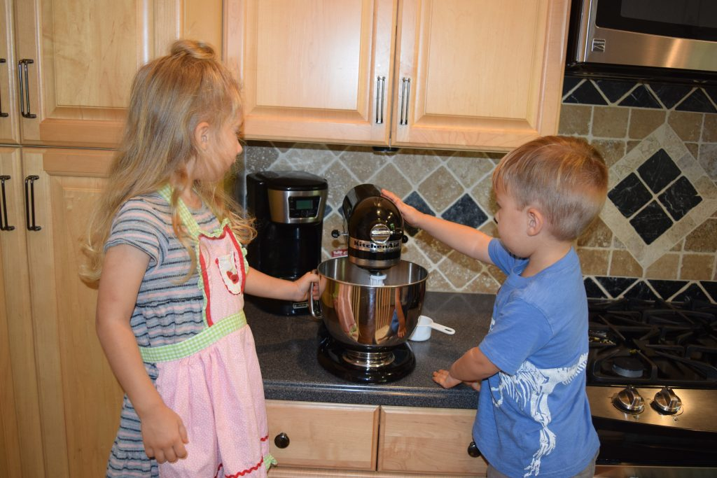 Avoiding making a homeschool mistake by involving kids in cooking.