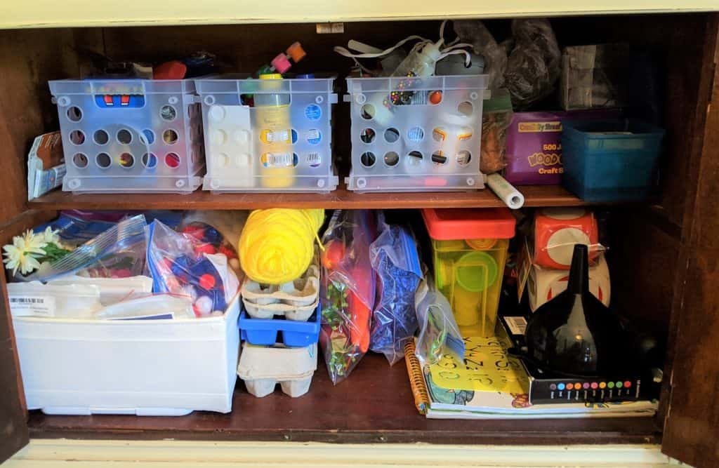 Using a dining room hutch to organize homeschool in dining room.